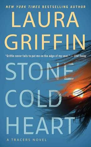a blue book cover with the words Laura Griffin on top and Stone Cold Heart on bottom with a sunset picture on the right side